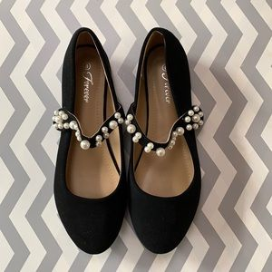 Forever black flats with velcro strap and pearls.